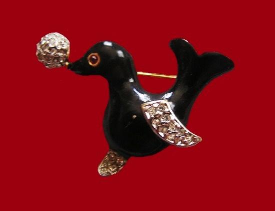 Seal with a ball brooch pin. Black enamel, gold tone alloy, rhinestones