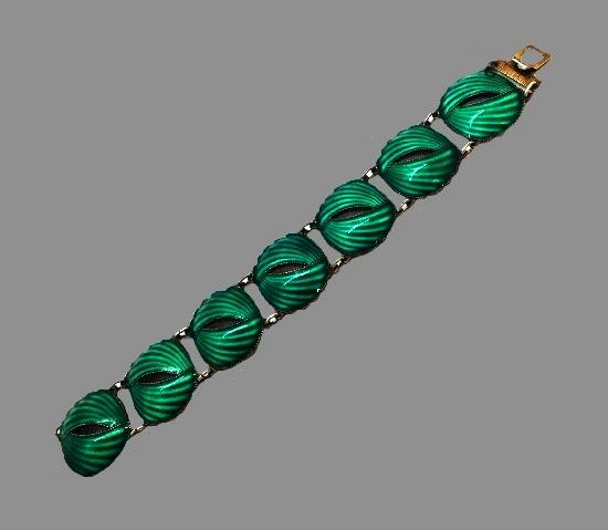 Shell design linked bracelet. Sterling silver, green enamel