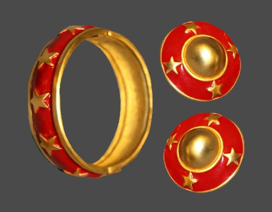Star design red enamel gold tone bracelet and clip on earrings