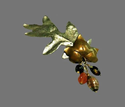 Two leaves dangling brooch. Brass and bronze tone alloy, glass beads