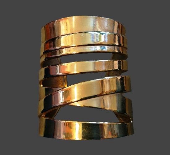Wide 7 cm gold tone cuff bracelet. 1980s