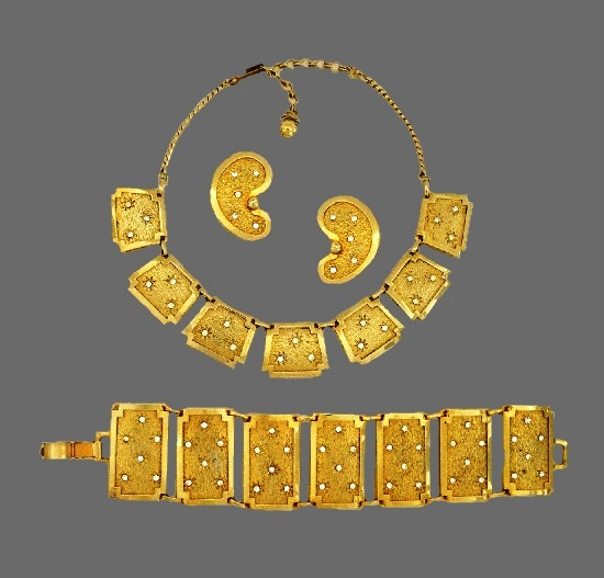 1956 Necklace, bracelet and earrings of goldtone with rhinestones