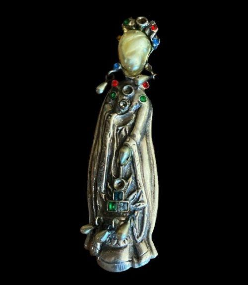 A woman with lantern brooch. Sterling silver, enamel, art glass. 7 cm. 1940s