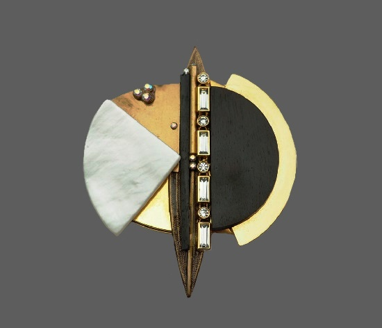 Abstract design brooch pendant. Gold tone metal, mother of pearl, crystals and wood