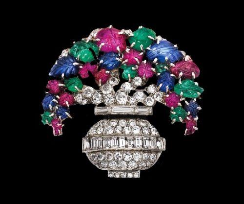 Basket of flowers brooch. Platinum, rubies, emeralds, sapphires, diamonds. 1920