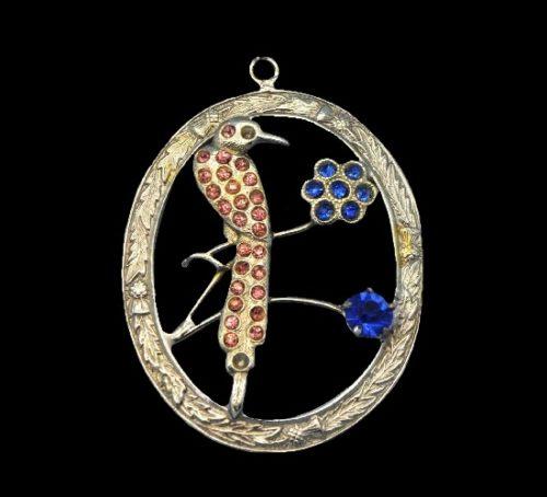 Bird pendant. Sterling silver, blue stones