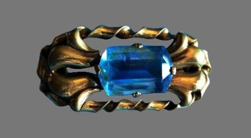 Blue glass bronze tone brooch