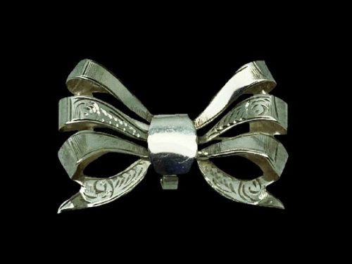 Bow brooch. Textured engraved sterling silver. 1962