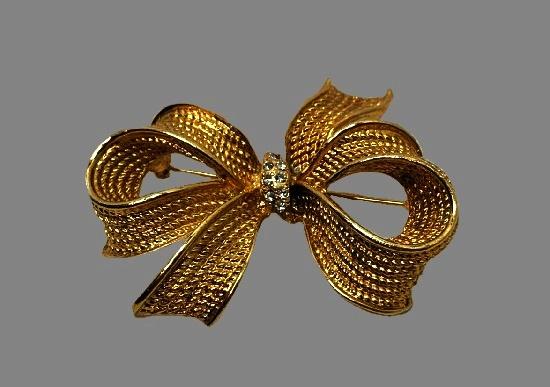 Bow brooch. Textured gold tone metal, rhinestones