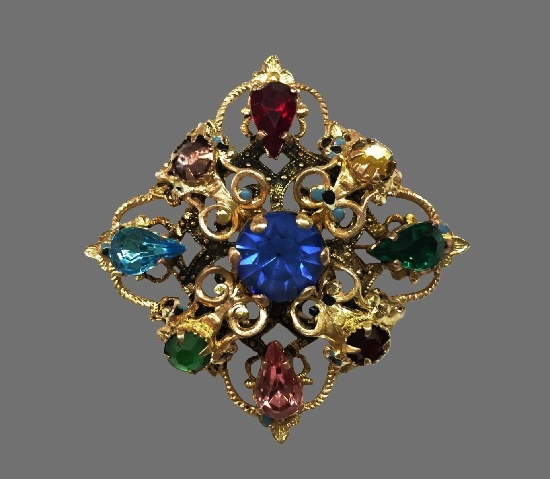 Brass multicolor crystal filigree brooch. 1930s. Marked Czecho. 4 cm