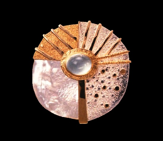 Round shaped handcrafted brooch. Sterling silver, 18k and 22k golds, mother of pearl, aquamarine. 1986