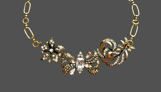 Butterfly flower and feather design necklace. Gold tone, rhinestones