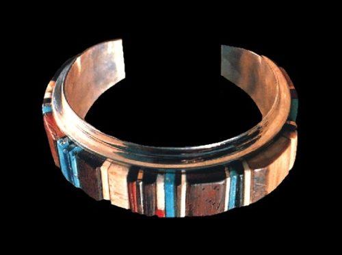 Cuff bracelet. 18k gold, channel-set turquoise, coral, ironwood, and mastodon ivory. 1980