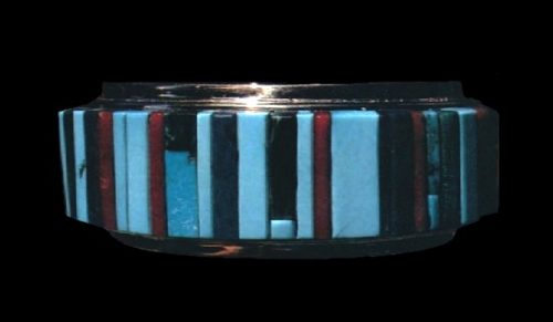 Cuff bracelet. 18 k gold, channel-set turquoise, coral, and lapis. 1980