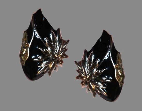 Curved wing shaped black enamel earrings. 1980s