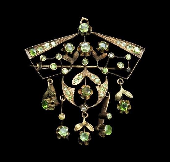 Early XX century transformer dangle brooch. Gold, demantoids, chrysolites