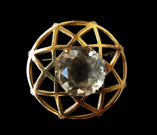 Eight-pointed star inside circle vintage brooch pin. Gold tone metal alloy, diamond cut crystal. 3.8 cm. 1950s