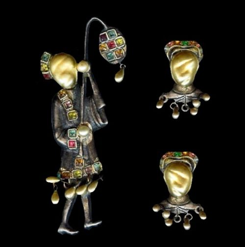 Exotic man with lantern brooch and clip on earrings. Silver, gold plated, rhinestone, faux baroque pearl. Brooch 7.2 cm, clips 2.5 cm. 1940s