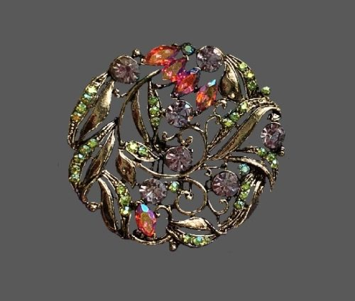Exquisite floral design round shaped brooch. Gold tone metal, rhinestones