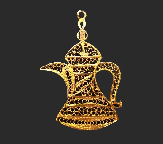 Filigree esign coffeepot pendant of gold tone signed SMB