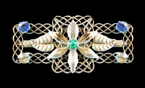 Filigree floral design brooch. Sterling silver, clear and blue crystals. 5.2 cm. 1930s