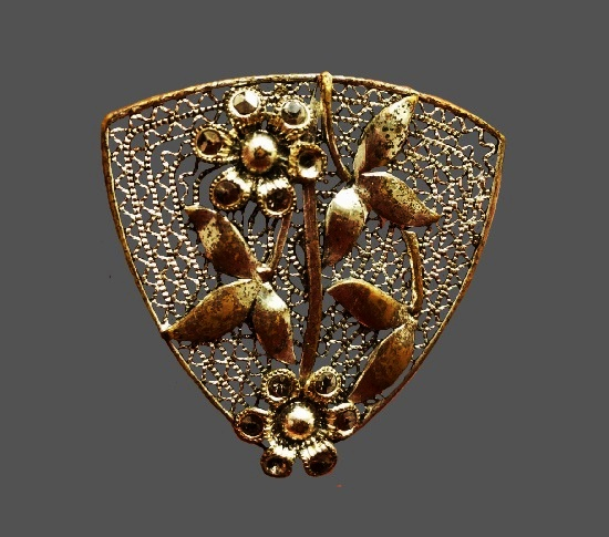 Flower Filigree brooch clip of gold tone. Before 1950