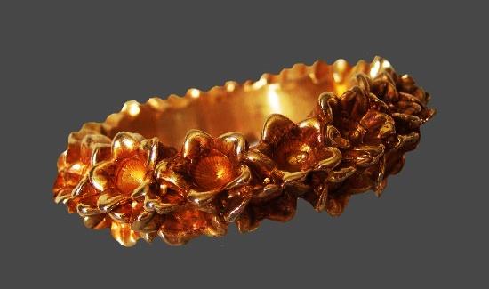Floral design gilt resin art glass bangle bracelet. 1980s.