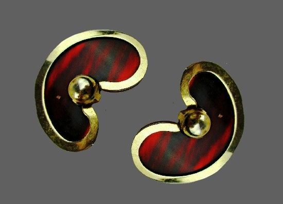 Gold tone metal red lucite clip on earrings. 1950s
