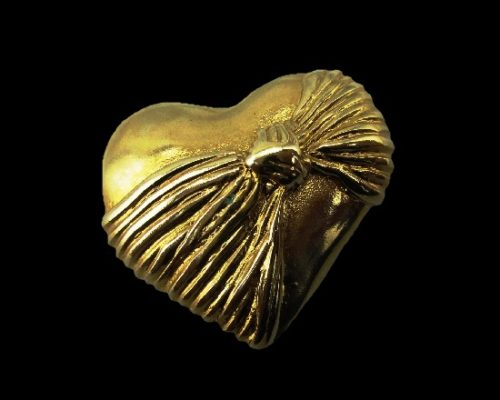 Heart signed with bow gold tone brooch pin. 1980s