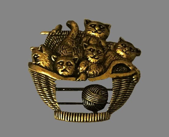 Kittens in yarn basket brooch. Gold tone metal alloy. 1995