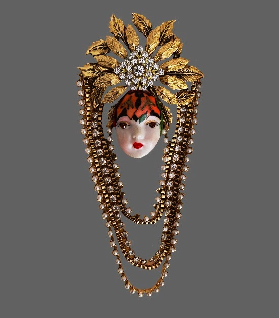 Lady's face with dangling gold metal and rhinestone chains Art deco brooch