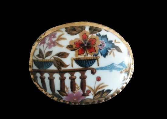 Landscape with flowers oval shaped porcelain brooch with gold tone trim