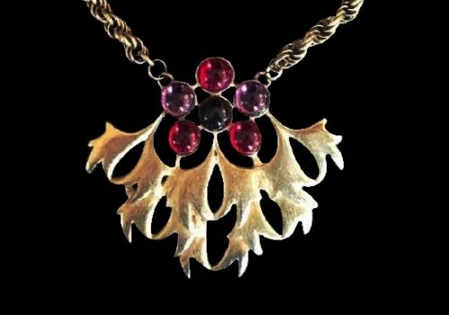 Leaf and flower design pendant. Gold tone metal, art glass. 1980s
