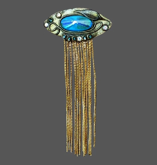 Leaf and vine design brooch. Turquoise glass cabochon, mother-of-pear, rhinestones, gold and silver tone metal. 1940s