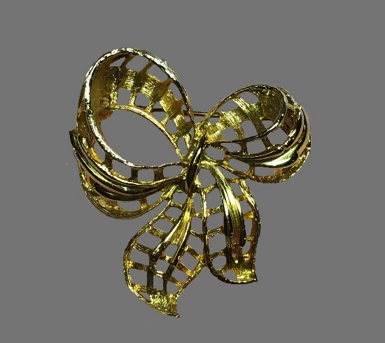 Bow gold tone brooch