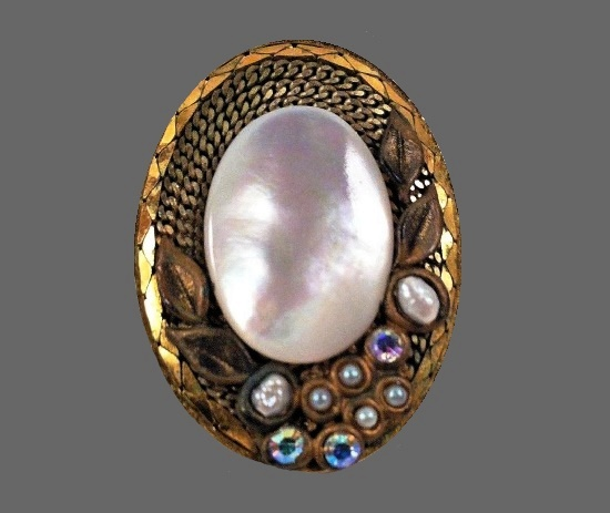 Oval shaped mother-of-pearl, rhinestones gold plated brooch