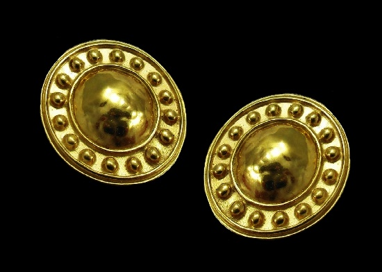 Round shaped gold tone clip on earrings. 1993
