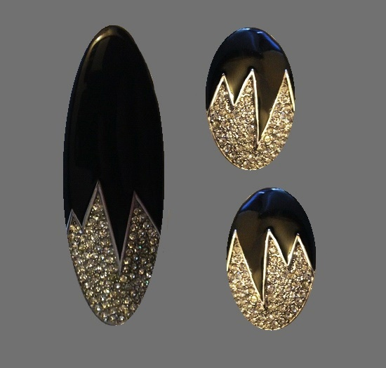 Silver and black tone brooch and clip on earrings. Black enamel, rhinestones. 1980s