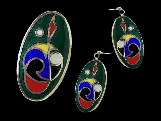 Silver tone oval shaped celtic design brooch and earrings