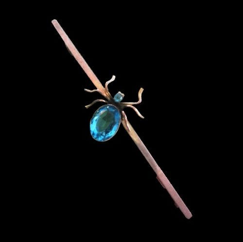 Spider bar brooch. 9 K gold, silver, blue topaz. Marked Chester 1921