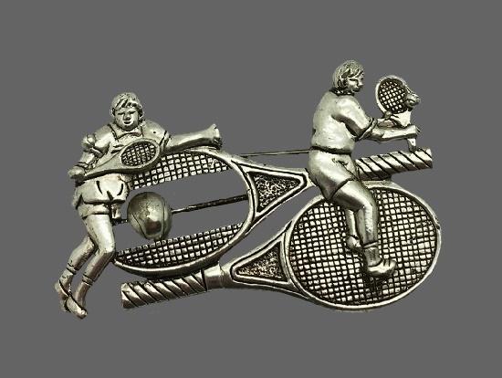 Tennis Players racquet ball brooch pin. Silver tone metal. 1995