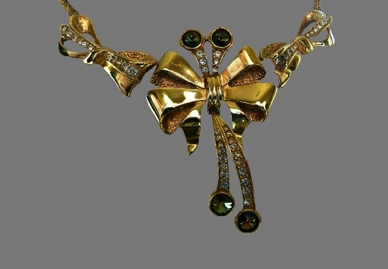 Three bows necklace. Gold plated metal alloy, rhinestones. 1980s