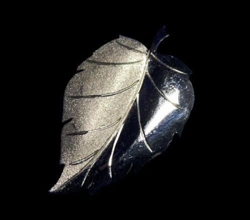 Two textured sterling silver leaf brooch. 1970