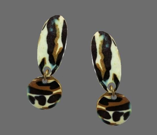 Animal print design dangle earrings. Gold tone metal, plastic