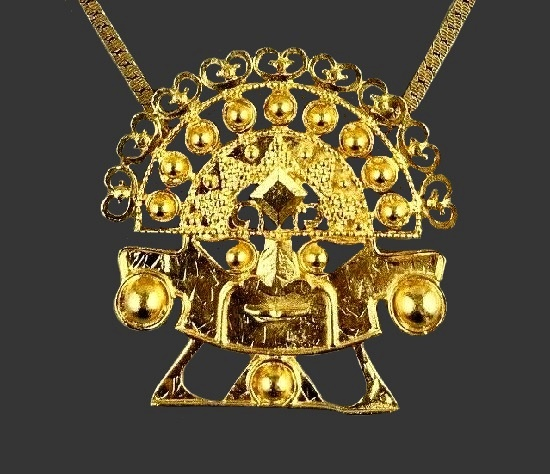 Aztec warrior gold tone pendant