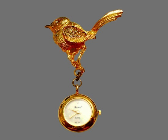 Bird brooch with watches. Gold tone, rhinestones. 7.6 cm. 1980s