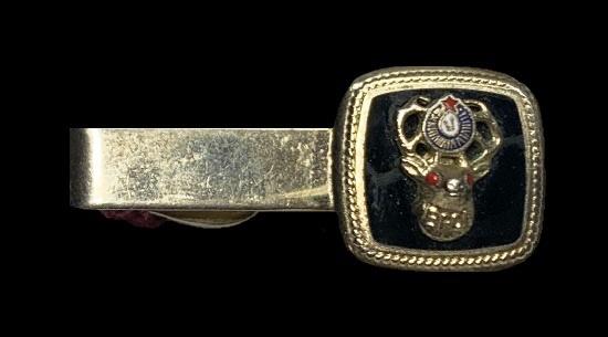 Black enamel gold tone tie clip