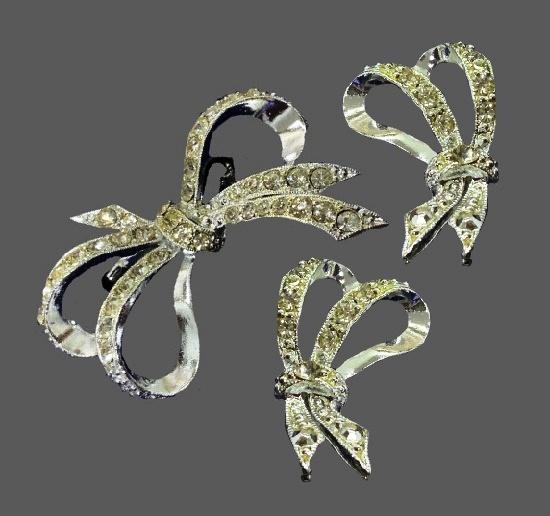 Bow brooch and earrings. Silver tone metal, clear rhinestones