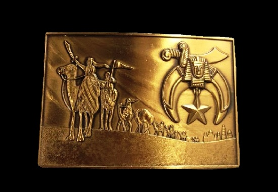 Caravan of the Wise Men pointing to the Star in the Easts, religious design belt buckle of brass tone. 1970s