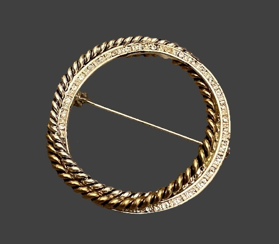 Circle pin of gold and silver tone